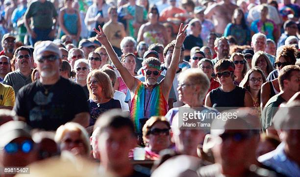 A fan flashes the peace sign during the concert marking the 40th anniversary of the Woodstock music festival August 15 2009 in Bethel New York On...