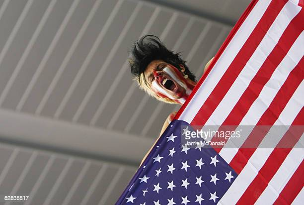 A fan from the USA celebrates his nation winning the Gold medal after defeating Australia in the final of the Wheelchair Rugby at the Beijing Science...