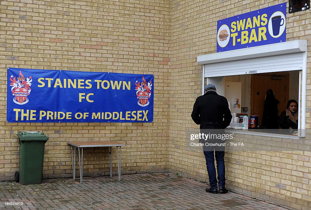 A fan gets a cup of tea before the FA Sunday Cup Semi Final match between Barnes Albion and Upshire at Wheatsheaf Park on March 24, 2013 in Staines, England,