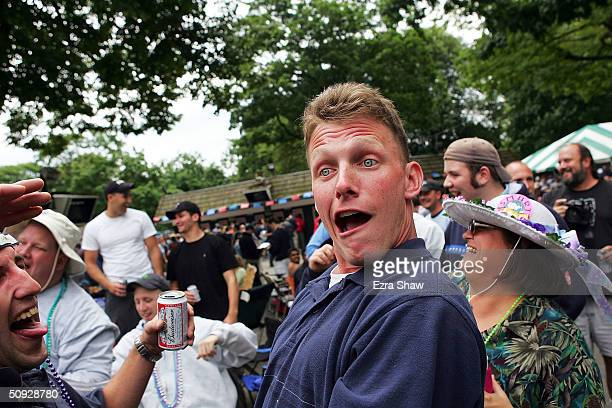 A fan gets a little drunk after drinking beer funnels before the running of the races on June 5 2004 at the 136th Belmont Stakes in Elmont New York