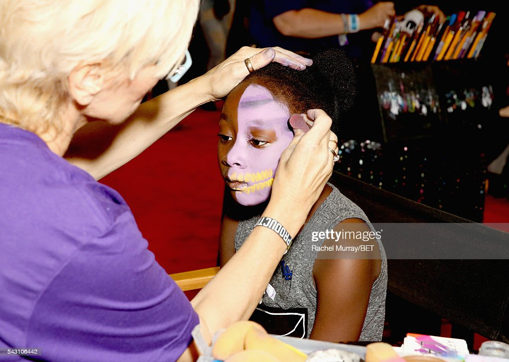 A fan gets her face painted at Fashion And Beauty @BETX presented by Progressive, Covergirl, Strength of Nature, Korbel and Macy's during the 2016 BET Experience on June 25, 2016 in Los Angeles, California.