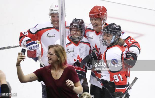 TORONTO ON NOVEMBER 12 A fan gets photo bombed by Brad Richards Danielle Goyette Mark Messier and Geraldine Heaney during the Hockey Hall of Fame...