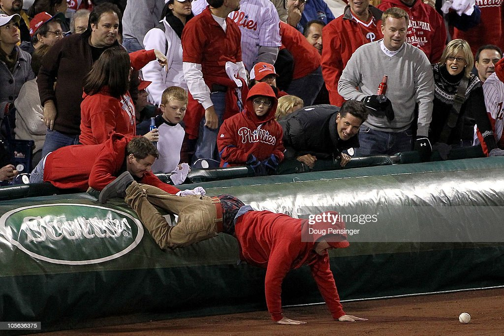 A fan goes after a foul ball in Game One of the NLCS during the 2010 MLB Playoffs between the San Francisco Giants and the Philadelphia Phillies at Citizens Bank Park on October 16, 2010 in Philadelphia, Pennsylvania.