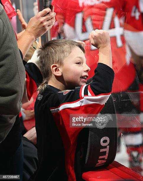 A fan greets the Ottawa Senators prior to the game against the St Louis Blues at the Canadian Tire Centre on December 16 2013 in Ottawa Canada