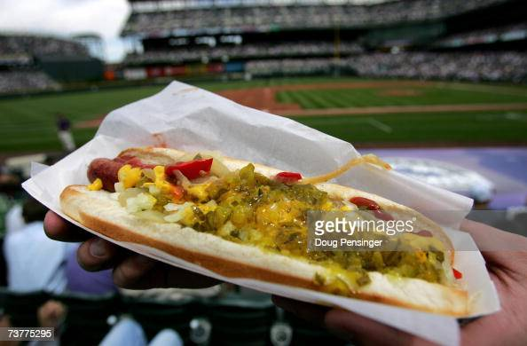 A fan has a loaded hotdog at the ready to celebrate Opening Day as the Arizona Diamondbacks face off against the Colorado Rockies on April 2 2007 at...