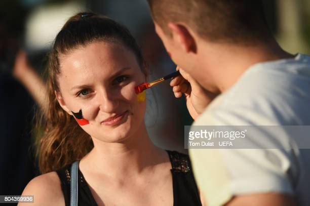 A fan has her face painted outside the stadium prior to the UEFA European Under21 Championship Final between Germany and Spain at Krakow Stadium on...