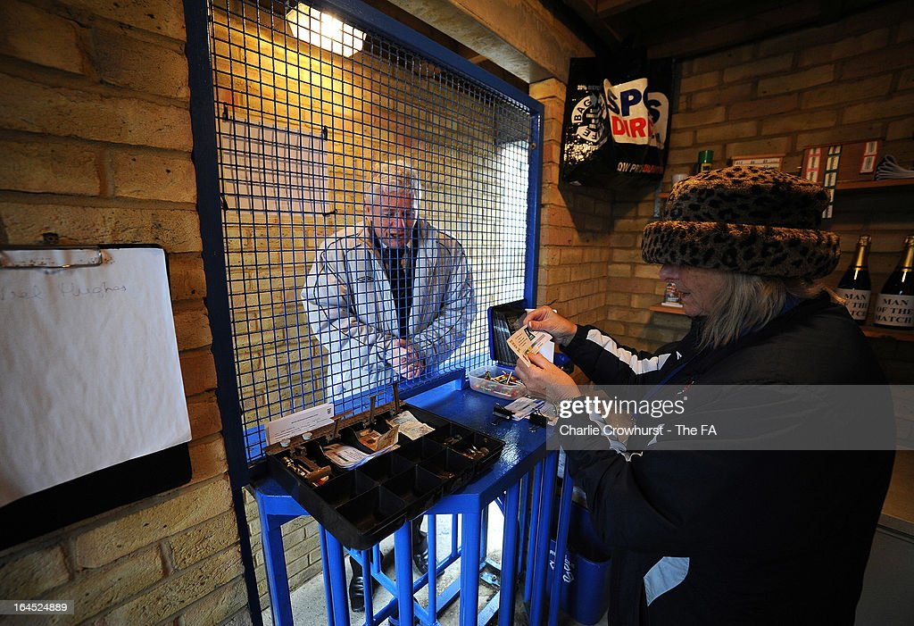 A fan has his ticket checked before making his way into the ground before the FA Sunday Cup Semi Final match between Barnes Albion and Upshire at Wheatsheaf Park on March 24, 2013 in Staines, England,