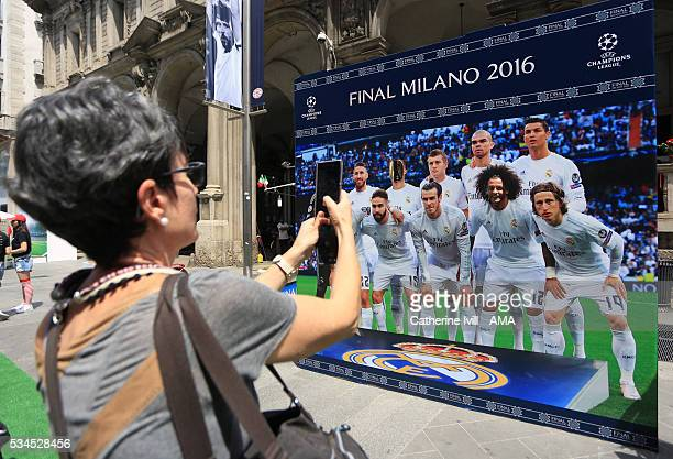 A fan has their photo taken in the Real Madrid team group at The Champions Festival prior to the final at Stadio Giuseppe Meazza on May 26 2016 in...