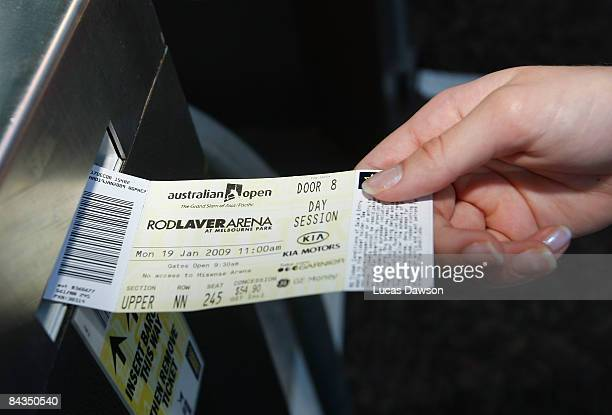 A fan has their ticket scanned in at an entry point during day one of the 2009 Australian Open at Melbourne Park on January 19 2009 in Melbourne...