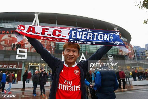 A fan hold a matchday scarf prior to the Barclays Premier League match between Arsenal and Everton at Emirates Stadium on October 24 2015 in London...