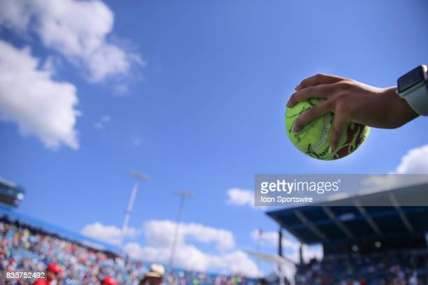 A fan hold out an autographed tennis ball at the Western Southern Open at the Lindner Family Tennis Center in Mason Ohio on August 18th 2017 Nadal...