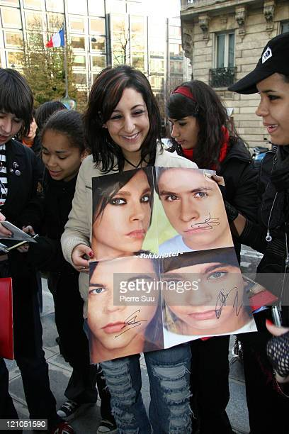 Fan holding a picture of 'Tokio Hotel' during German Boy Band 'Tokio Hotel' Sighting in Paris November 27 2006 at Paris in Paris France