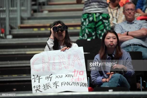 A fan holding a telescope watches Men's Doubles final match between Xu Xin and Fan Zhendong of China Masataka Morizono and Yuya Oshima of Japan on...