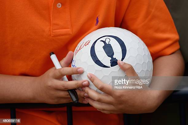 A fan holds a ball as he waits for autographs ahead of the 144th Open Championship at The Old Course on July 14 2015 in St Andrews Scotland
