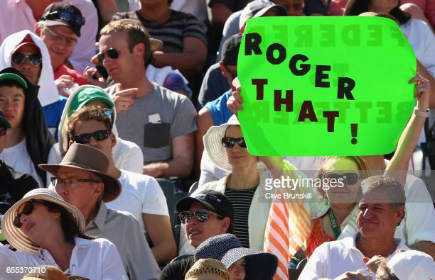 A fan holds a banner for Roger Federer of Switzerland as he plays against Stanislas Wawrinka of Switzerland in the mens final during day fourteen of...