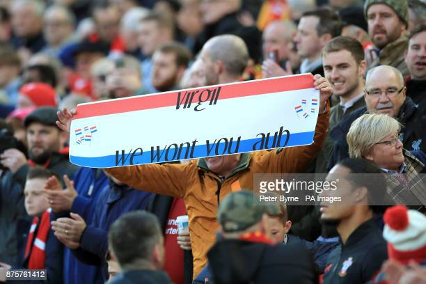 A fan holds a banner for Southampton's Virgil van Dijk in the stands during the Premier League match at Anfield Liverpool
