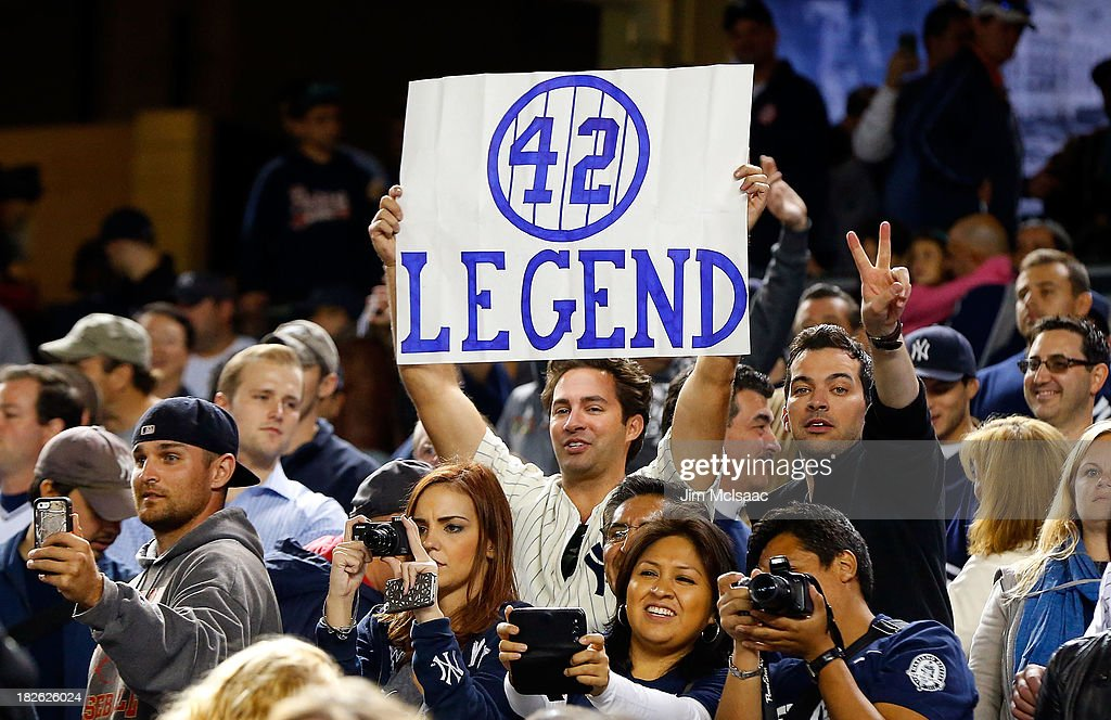 A fan holds a banner in reference to Mariano Rivera #42 of the New York Yankees after a game against the Tampa Bay Rays at Yankee Stadium on September 26, 2013 in the Bronx borough of New York City. The Rays defeated the Yankees 4-0.