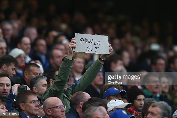A fan holds a banner to protest against technical director Michael Emenalo during the Barclays Premier League match between Chelsea and Sunderland at...