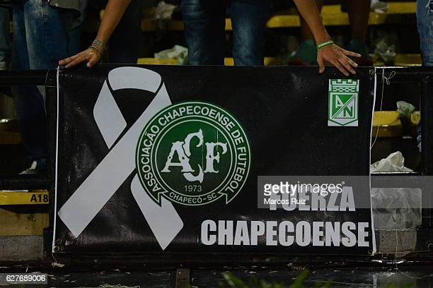 A fan holds a banner to show support to Chapecoense during a match between Millonarios and Atletico Nacional as part of the Liga Aguila II 2016 at...