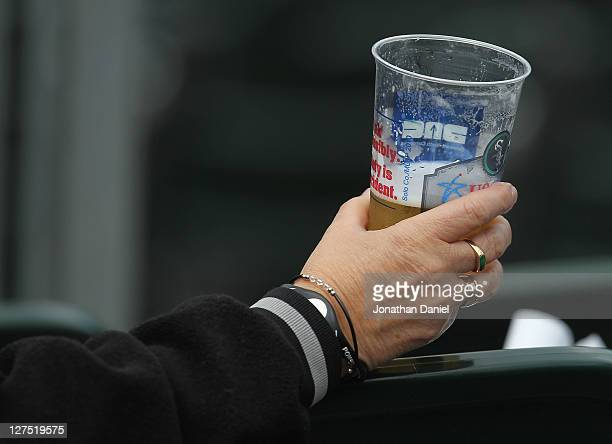A fan holds a beer during the last game of the season between the Chicago White Sox and the Toronto Blue Jays at US Cellular Field on September 28...