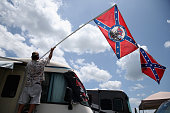 A fan holds a Confederate flag during practice for the NASCAR XFINITY Series Subway Firecracker 250 at Daytona International Speedway on July 3 2015...