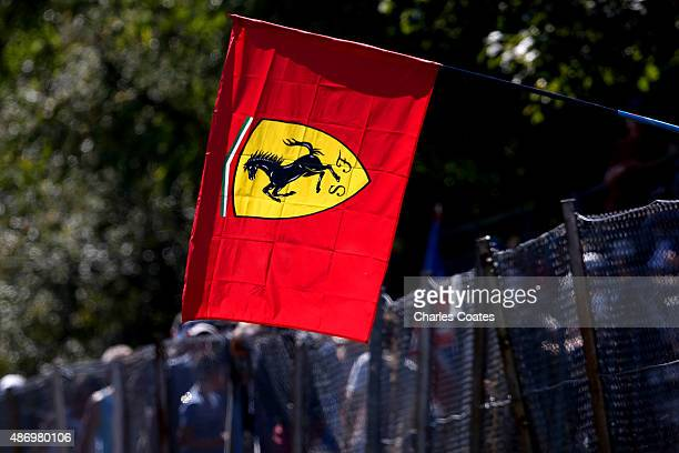A fan holds a Ferrari flag during qualifying for the Formula One Grand Prix of Italy at Autodromo di Monza on September 5 2015 in Monza Italy