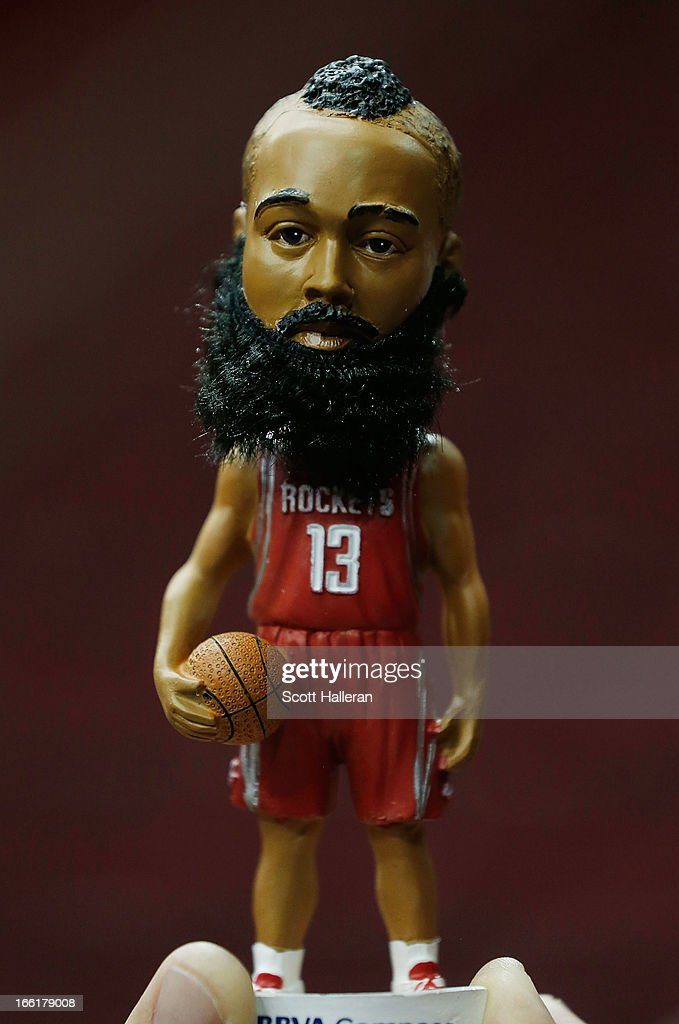 A fan holds a James Harden bobblehead doll before the start of the game between the Houston Rockets and the Phoenix Suns at the Toyota Center on April 9, 2013 in Houston, Texas.
