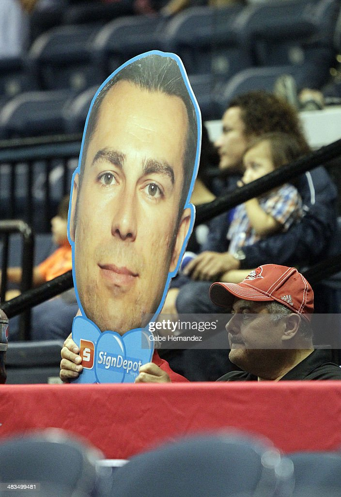A fan holds a photo cut out of head coach Nevada Smith of the Rio Grande Valley Vipers as they play against the Iowa Energy on April 8, 2014 during game one first round of the 2014 NBA-Development League playoffs at the State Farm Arena in Hidalgo, Texas.