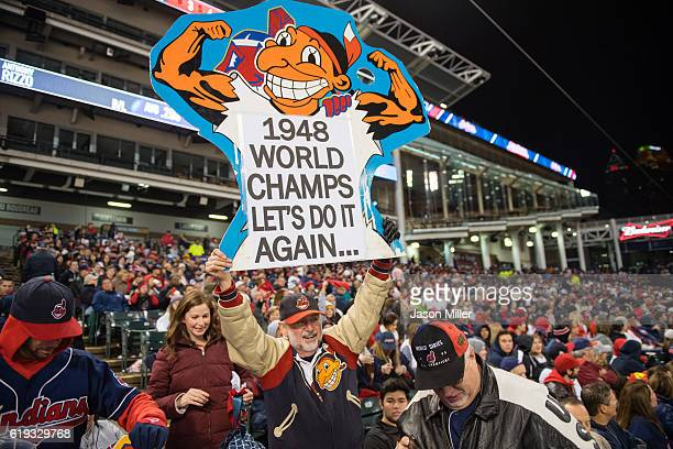 A fan holds a sign celebrating the 1948 champs during the Cleveland Indians World Series Watch Party at Progressive Field on October 30 2016 in...