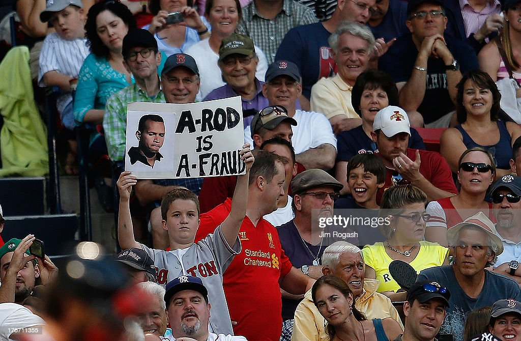 A fan holds a sign critical of Alex Rodriguez #13 of the New York Yankees during a game with the Boston Red Sox at Fenway Park on August 17, 2013 in Boston, Massachusetts.