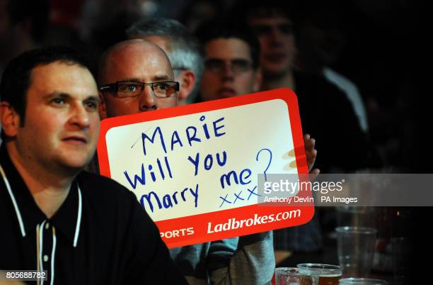 A fan holds a sign proposing marriage during the Ladbrokescom World Darts Championship at Alexandra Palace London