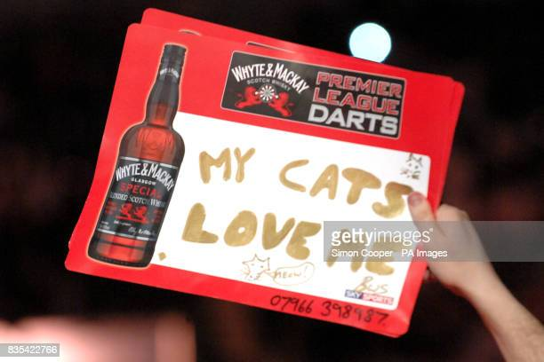 A fan holds a sign saying My cats love me