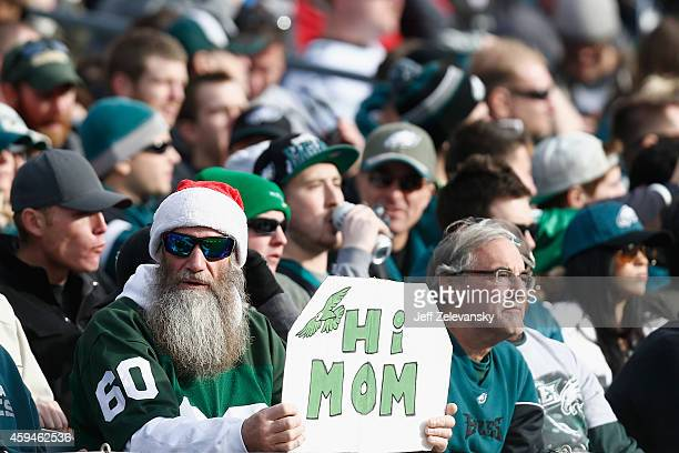 A fan holds a sign that reads 'Hi Mom' during the game between the Philadelphia Eagles and the Tennessee Titans at Lincoln Financial Field on...