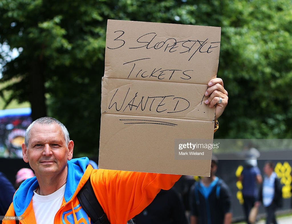 A fan holds a sign trying to buy tickets for the Mountain Bike Slopestyle Final competition at Munich Olympic Park on Day 4 of the X-Games on June 30, 2013 in Munich, Germany.