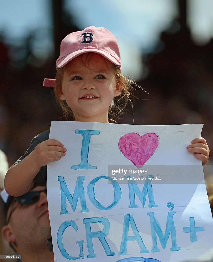 A fan holds a sign up for Mother's Day during a game between the Boston Red Sox and the Toronto Blue Jays on May 12, 2013 at Fenway Park in Boston, Massachusetts.