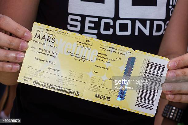 A fan holds a ticket of the concert of American band Thirty Seconds To Mars