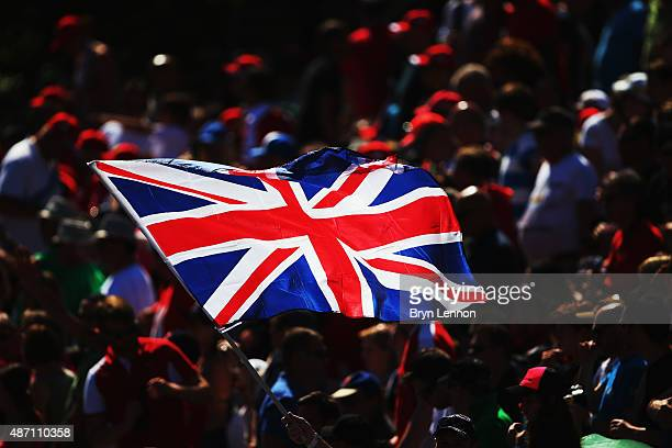A fan holds a Union Jack in the air during the Formula One Grand Prix of Italy at Autodromo di Monza on September 6 2015 in Monza Italy