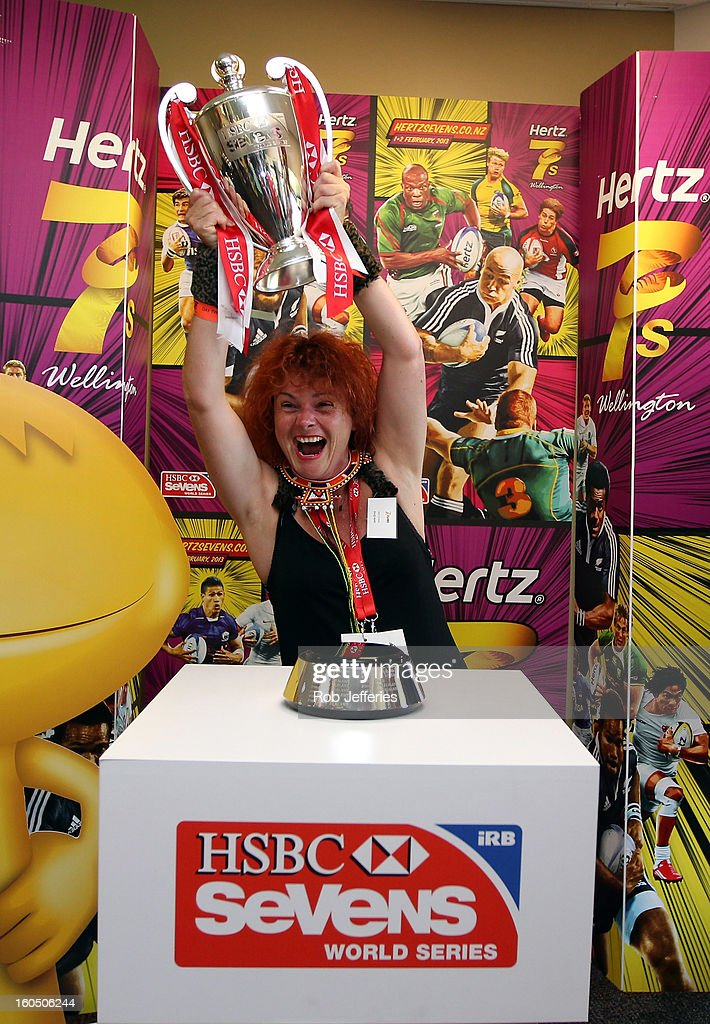 A fan holds aloft the HSBC Sevens World Series Trophy during the Hertz Sevens, Round four of the HSBC Sevens World Series Westpac Stadium on February 2, 2013 in Wellington, New Zealand.
