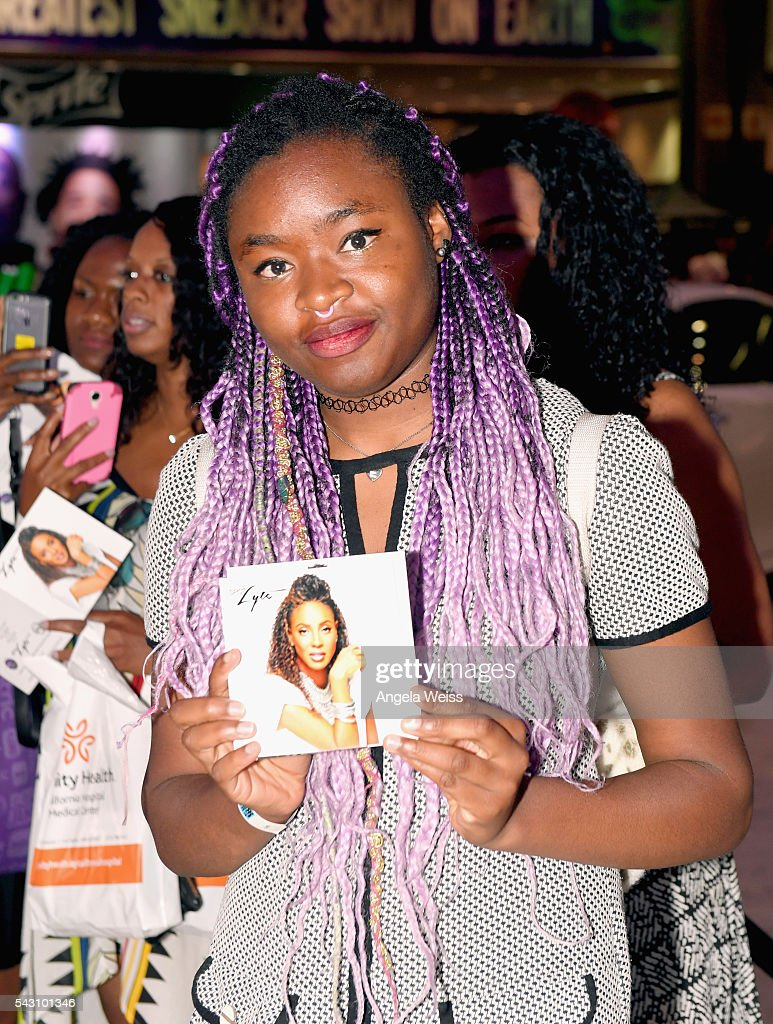 Fan holds an album by rapper MC Lyte FAN FEST during the 2016 BET Experience on June 25, 2016 in Los Angeles, California.