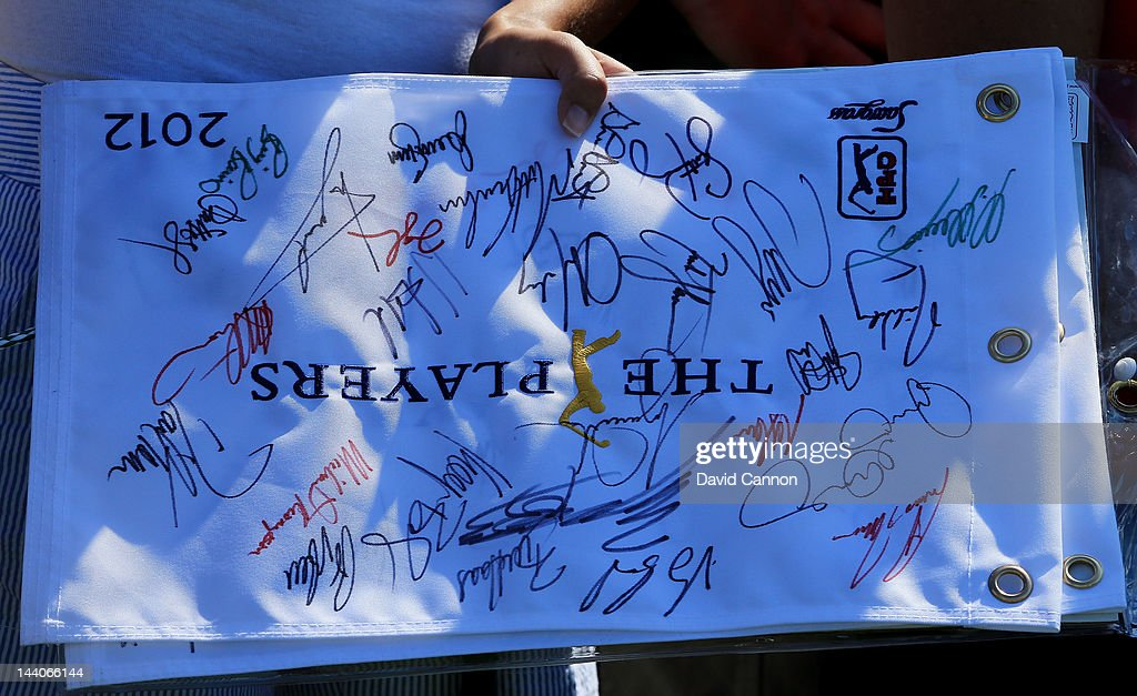 A fan holds an autographed flag that says 'THE PLAYERS' during a practice round prior to the start of THE PLAYERS Championship held at THE PLAYERS Stadium course at TPC Sawgrass on May 9, 2012 in Ponte Vedra Beach, Florida.