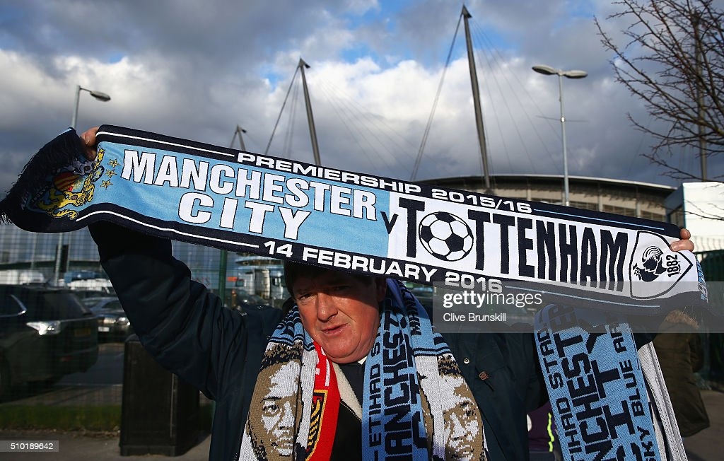 A fan holds the match scarf prior to the Barclays Premier League match between Manchester City and Tottenham Hotspur at Etihad Stadium on February 14, 2016 in Manchester, England.