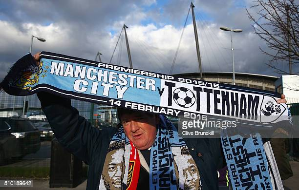 A fan holds the match scarf prior to the Barclays Premier League match between Manchester City and Tottenham Hotspur at Etihad Stadium on February 14...
