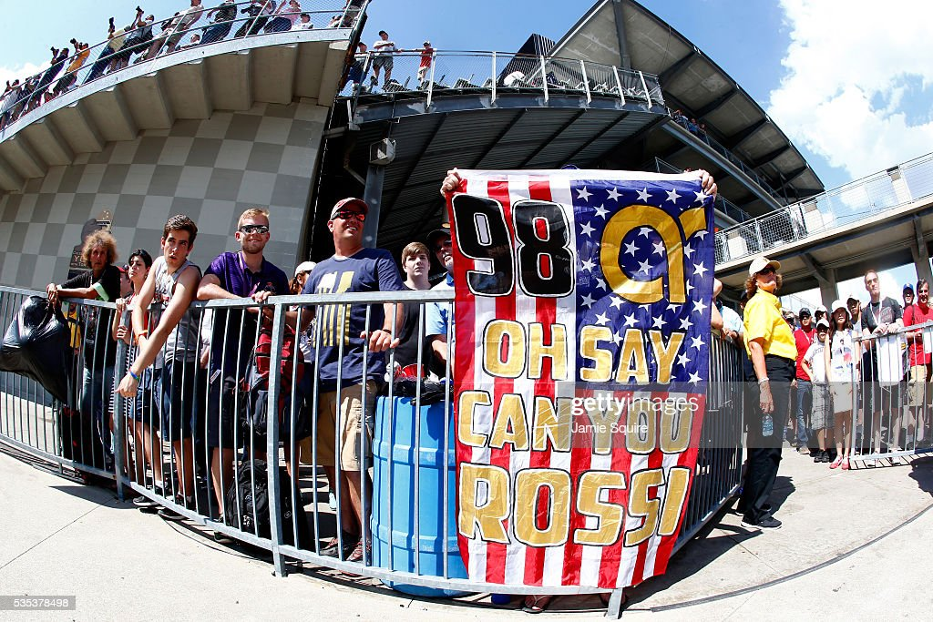 A fan holds up a banner after Alexander Rossi of the United States, driver of the #98 Andretti Herta Autosport Honda Dallara, won the 100th running of the Indianapolis 500 at Indianapolis Motorspeedway on May 29, 2016 in Indianapolis, Indiana.