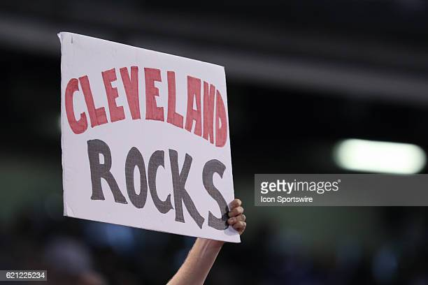 A fan holds up a 'Cleveland Rocks' sign during game 7 of the 2016 World Series against the Chicago Cubs and the Cleveland Indians at Progressive...