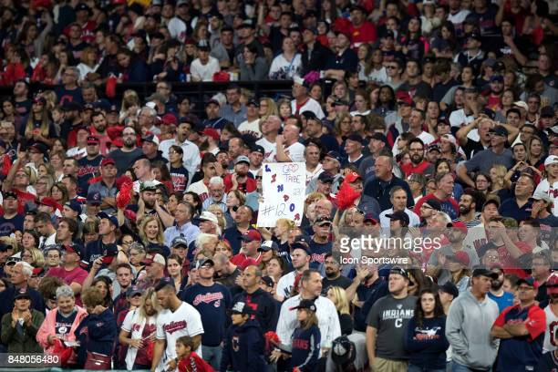 A fan holds up a Francisco Lindor sign as Lindor steps to the plate with 2 outs in the ninth inning of the Major League Baseball game between the...