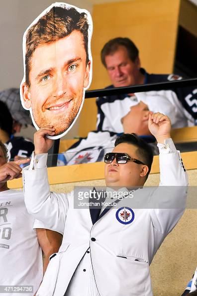 A fan holds up a large cutout of Blake Wheeler of the Winnipeg Jets during firstperiod action between the Jets and the Anaheim Ducks in Game Three of...