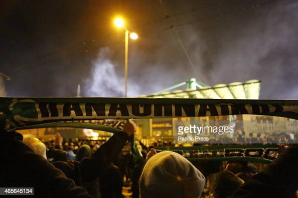 STADIUM ATHENS ATTICA GREECE A fan holds up a Panathinaikos scarf Fans of Greek football club Panathinaikos FC watch the game against PAOK FC from...