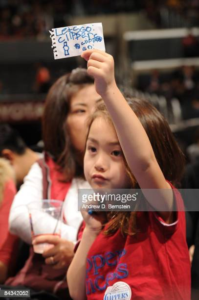 A fan holds up a sign during a game between the Milwaukee Bucks and the Los Angeles Clippers at Staples Center on January 17 2009 in Los Angeles...