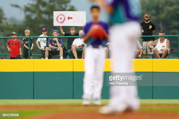 A fan holds up a sign during Game 3 of the 2017 Little League World Series between the Canada team from British Columbia and the Europe Africa team...