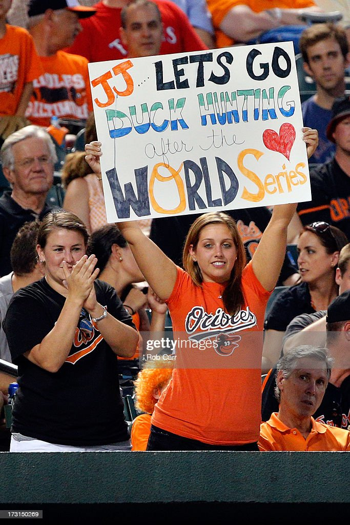 A fan holds up a sign during the fifth inning of the Baltimore Orioles and Texas Rangers game at Oriole Park at Camden Yards on July 8, 2013 in Baltimore, Maryland.